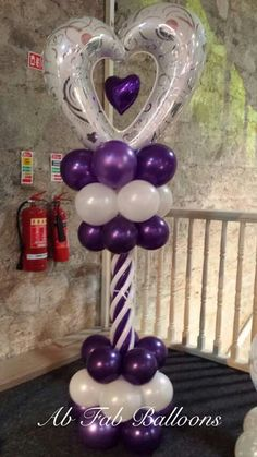 Balloon Column in white and purple. Love the heart shaped foil balloon as topper, with the small heart inside.
