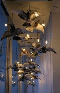 Evocative taxidermy bird lighting by Alex Randall, shared by Dolly Kei.  -- Eve.