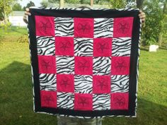 Custom pink and zebra striped Baphomet baby quilt.
