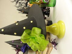 """Witch hat"" from Michael's with painted dots & fabric bow. Candle stick as holder."