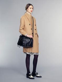 camel coat and oxfords