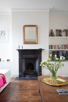 See all our stylish living room design ideas on HOUSE by House & Garden, including this sitting room in a London flat designed by Harriet Anstruther, which features a black chimneypiece and white modern furniture. Eclectic Living Room, Living Room Green, New Living Room, Living Room Modern, Living Room Designs, Living Room Decor, Decor Room, Wooden Floors Living Room, Living Room Vinyl