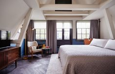 A new Hoxton Hotel opens in a 17th Century canal house in Amsterdam: While attic rooms feature original wooden ceilings beams.