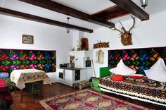 (BrandonRugs.com) Textile art (including oriental rugs, of course) IS art, and rightfully deserves to be proudly displayed along with other treasured art you have collected (or created). (Fabulous Romanian home)