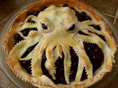 Sandy Yoo, an artist based in California, isn't afraid to tempt fate tantalizing the Great Old Ones by baking a pie bearing the unmistakable likeness of Dread Cthulhu. Eat the pie before it devours your soul. Then again, perhaps the soul-devouring doesn't begin until the pie is already in your belly. And if the pie in question is tasty enough, we have to admit it might just be worth the risk. Mmm…pie… Cthulhufhtagn Photo via Meaningless Drivel forum at JavaRanch [via Laughing Squ...