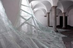 SO COOL. Aerial is a new site-specific installation by Baptiste Debombourg (previously) at an old Benedictine monastery called Brauweiler Abbey near Cologne, Germany. Debombourg used numerous sheets of shattered laminate glass to mimic a frothy flood of water rushing into a room