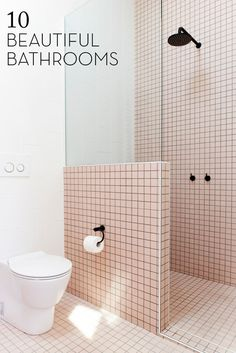 Stunning retro-chic!  Pastel pink tiling with black accents