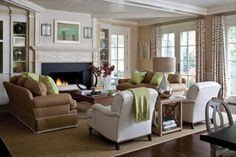 rich tans, warm creams, and color accents; beautiful fireplace with navy pop