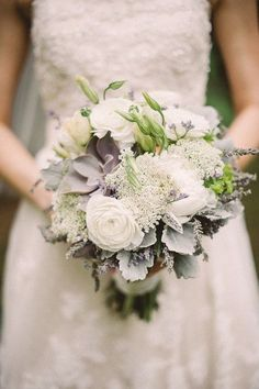 mnesia roses, blush spray roses, silver brunia, pale green and purple succulents, fresh lavender, queen anne's lace, and grey dusty miller wrapped in grey ribbon with the stems showing