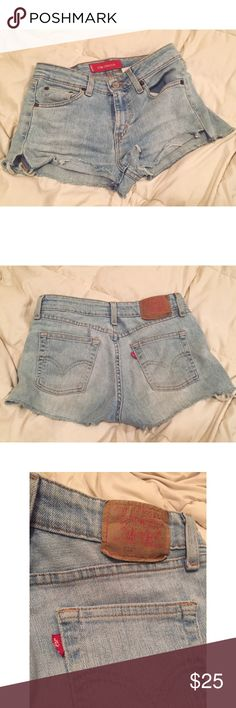 """🌹Cut-off Vintage Levi's Mid-waisted jean shorts. Light wash. Stretch in the Jean. // Measurements: 9"""" crotch. 14.5"""" across waist. 10"""" length in front. 11"""" length in back. // Would fit 25-26 size Levi's Shorts Jean Shorts"""