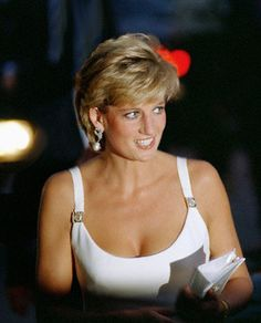 1995. The princess began to favor sheath dresses that showed off her slim shape, like this white Versace number she wore for a charity concert in Italy