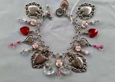 $105.00 chain and charms FINE SILVER 99% Sterling.......Romantic Brass Heart charm bracelet/ceramic by LeilaBeeDesigns