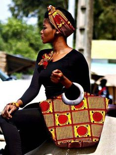 Loving the bag matched with her headwrap