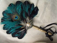 I want this divine peacock fan. And a manservant who will fan me with it while I lie in my chaise.
