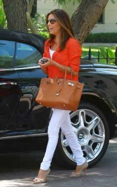 White skinny jeans and orange shirt. Not the bag or heels