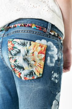 Belts made by beads, Hawaiian white flowers for the denim and flowery pockets to make this trousers look different :)