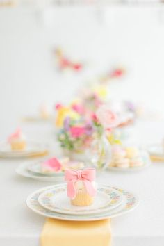 Bright and colorful tea party table decor: http://www.stylemepretty.com/living/2017/02/03/a-flower-and-tutu-inspired-tea-party-for-the-littlest-loves/ Photography: Andrew & Jade - http://andrewjadephoto.com/