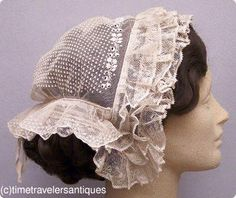 1850s daycap,  a finely hand-embroidered fancy tulle day cap, trimmed in ruffled Mechlin lace with adjustable twill tape drawstring at the back.