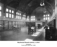 """Wychwood Library opened April 15, 1916. It was the first and model of 3 identical libraries (High Park & Beaches were the others) that TPL built with a $50,000 grant from Carnegie. Eden Smith's design, an adaptation of Tudor Gothic style, was """"an almost entire departure from the traditional library building…the Reading room & Library, 70 ft long by 30 ft wide…is really a large hall with an open timbered roof, the walls above 19 ft high to the springing of the roof..the ceiling 29 ft at its…"""