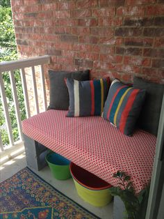 Cinder block bench made from crib mattress.. use a shower curtain to make the cover.