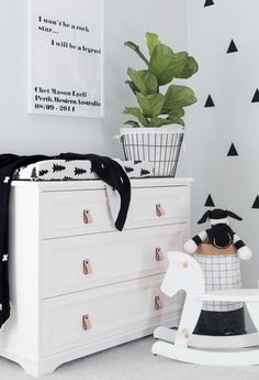 Fresh blank space with fiddle leaf fig plant, simple quote and triangle wall design. modern nursery