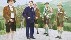 Adolf Hitler in Color He was ruler of all of Germany and committed some of the most atrocious war crimes of all time. This image of Hitler is so incredibly rare as it is one of the only images of him in color. He is dressed in a blue suit and tie with a hunting party in traditional costume in Bavaria, Germany. This image was apparently used on cigarette cards and was taken somewhere between 1932 and 1935.