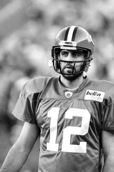 Aaron Rodgers; I swear my life won't be complete until I meet him.