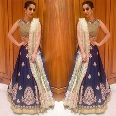 Semi-Stitched Bollywood Inspired Wedding Wear Lehenga Choli  Default Size : Free Size  Fabric :  Colour : Blue  Lehenga Fabric : Tapeta Silk  Blouse Fabric : Tapeta Silk  Dupatta Fabric : Net  Work : Heavy Embroidered , Border Work , Cut Work , Multy Work , Thread Work  Occasion : Party, Festival, Wedding Wear, Ceremony Price : 2750/- For Order whatsapp us at +91-9311187463 or you can also Visit our website : http://www.suit-sarees.com