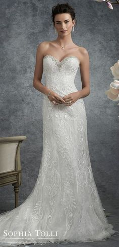 A-line Wedding Dresses : Slim A-line lace wedding dress. Strapless metallic lace over misty tulle and sof