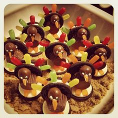 Oreo cookies, mini Reese's cups, whoppers, mike and Ike's, and frosting with brown sugar for presentation. Showing up to thanksgiving with the family with fun treats!  Much easier than I thought it would be and so much fun to make!
