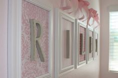 Idea for kids' names on wall - use frames, scrap book paper and letters. No glass.