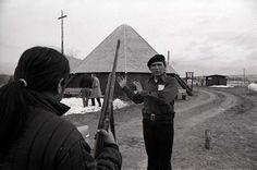 AIM leader Dennis Banks talks with AIM member during occupation, 1973.  Photo credit: Jim Hubbard