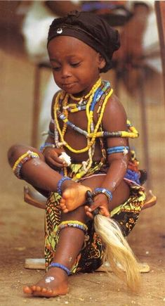 A young Krobo child from Ghana. I actually attended a traditional ceremony in Krobo