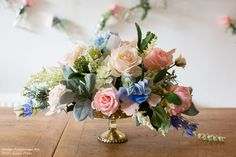 Beautiful centerpiece created with faux flowers from afloral.com by Pumpkin and Pye, photos by Evolve Photo. #fauxflowers