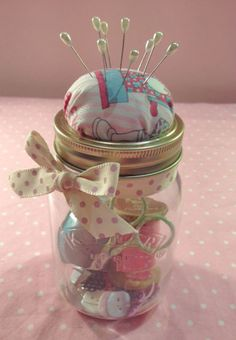 These pincushion jars are so easy to make, and are a great idea for a simple but thoughtful present at Christmas time. Fill with a selection of sewing goodies according to your recipient - ribbons, thread, buttons, scissors, or whatever else you like!