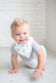 - Phoenix Designs for Boys - Designs include black and red gingham, black and white teepees, green cactus, and tan coyotes. - Absorbent cotton drool bib - These stylish drool bibs are made of 100% abs