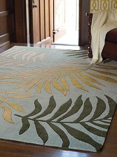 Featuring oversized palm leaves and stunning colors, the Biscayne Bay EZ Care Rug is the perfect combination of beauty and comfort.