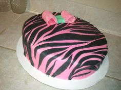 Pink Zebra outside, vanilla pound cake & lemon filling inside. Email me at MissiFizzleFaith@yahoo.com if you're in the Kansas City metro area!
