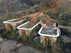 Soak in the rejuvenating waters of Mystic Hot Springs in Utah.