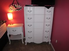 After: Tall French Provincial dresser and nightstand in high gloss white and silver hardware. (not for sale)