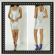 🎀 SILVER  SEQUIN BODYCON DRESS 🎀 TOTALLY  SEXY , ZIP BACK CLOSURE,  TANK STYLE  SILVER SEQUIN  DRESS, DOES STRETCH,  YET DRAPES  THOSE CURVES  SO NICELY.  FULLY LINED,  LIGHT WEIGHT  100% POLY,  PERFECT FOR ANY OCCASION & ALL YEAR ROUND.  ALL ITEMS SHOWN ARE LISTED IN MY CLOSET.  (PLZ ASK 4 SIZING BEFORE PURCHAE) Rue Dresses Mini