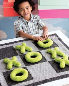 """Knitting Pattern for Jumbo Tic-Tac-Toe - Plush game played with softie letters on a blanket Game board Approx 30 x 30""""/76 x 76cm,X pieces Approx 5 x 6""""/12.5 x 15cm ,O pieces Approx 6 x 6""""/15 x 15cm. One of the patterns in60 Quick Knitted Toys. Designed by Jacob Seifert"""
