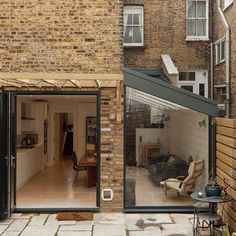 House extension design - This glazed side extension has a real WOW factor an effortless combination of the old brick, and modern steelwork Designed by Resi…