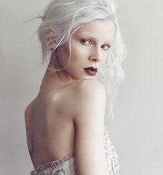 White hair. Love her look.