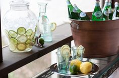 Give guests a healthy option with fresh flavored waters. Fill a big drink dispenser with ice water, flavored with fresh ingredients for a healthy thirst quencher on hot days. Try lemon, lime or orange slices; fresh mint leaves; cucumber rounds; or berries.
