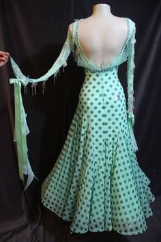 EM Salonas sponsor gown for sale. Mint green color with polka dots. Circle accents on neckline and sleeves. Ruffle detail on bodice and covered in stones. V-shaped back with attached floats. Size adult small. $2600 USD or best offer.