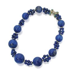 Lapis Lazuli, Turquoise and Diamond Necklace, Cartier Composed of lapis lazuli beads measuring approximately 27.0 to 5.9 mm, accented by turquoise cabochons, further set with round and baguette diamonds, signed Cartier, numbered 53 47575.