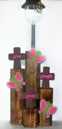3 Crosses with love, live, laugh, handpainted ceramic with painted wood butterflies. The base is a finished landscape timber with a solar light. Landscape Timber Crafts, Landscape Timbers, Landscape Design, Solar Lamp, Solar Lights, Lawn Lights, Wrapping Ideas, Wooden Crafts, Diy Crafts