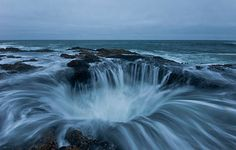 Thor's Well- Oregon Coast  Cape Perpetua is located about 2 miles (3 km) south of Yachats, Oregon along U.S. Route 101. It is a typical Pacific Northwest headland, forming a high steep bluff above the ocean. At its highest point, Cape Perpetua rises to over 800 feet (240 m) above sea level. (This photo must of been taken from a plane) @pat huston