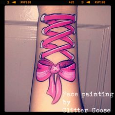 Ribbon corset body art by Glitter Goose! Hot pink bow laced face painting paint ideas.